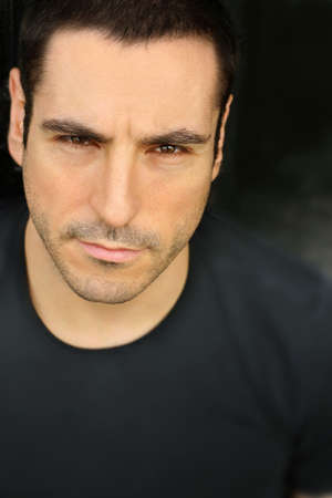 Close-up portrait of man against black Stock fotó
