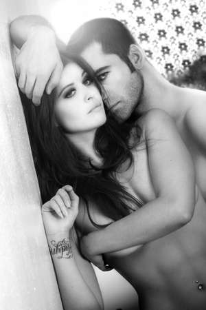 boy  naked: Black and white portrait of a sexy male and female couple Stock Photo