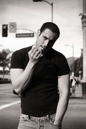 dangerous man: Classic black and white portrait of rugged good looking man smoking Stock Photo