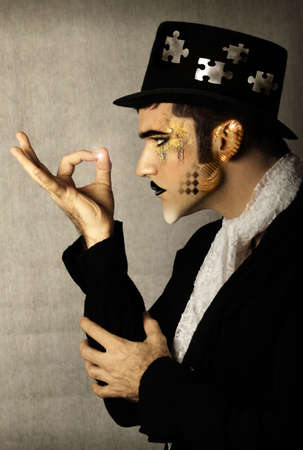 Fantastical stylized portrait of man in top hat and period clothing with light at his fingertips photo