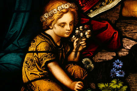 Beautiful stained glass of a little girl and flowers photo