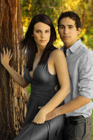 Portrait of beautiful young woman and man in outdoor setting