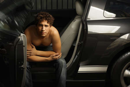 Portrait of a good looking young male model in his car  Stock Photo - 7136133