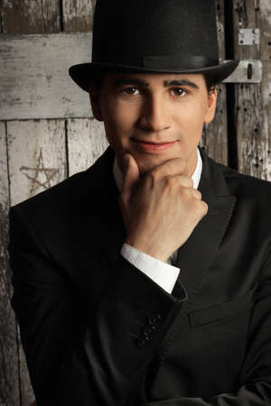 Young male model in top hat