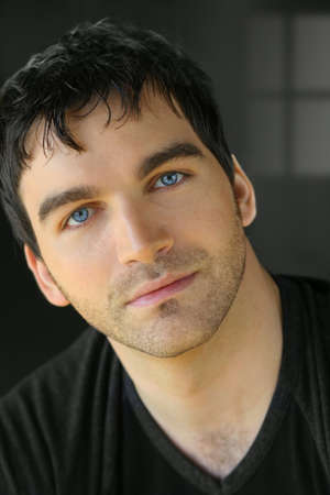 black hair blue eyes: Portrait of a nice young attractive man with blue eyes