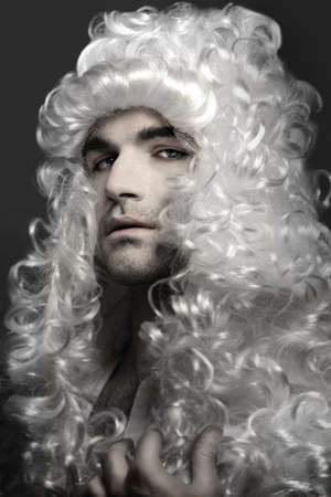 prominent: Noble young man in white powder makeup and wig