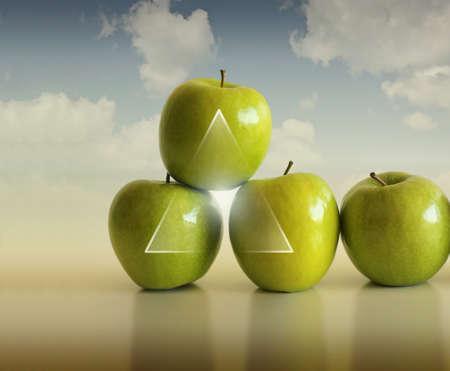 Abstract concept foto van een groep van appels ondersteunen elkaar tegen de achtergrond van de moderne  Stockfoto