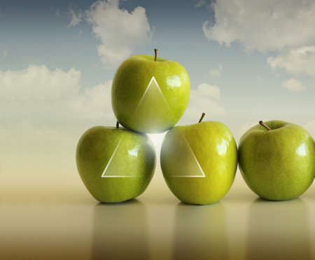 strong partnership: Abstract conceptual photo of a group of apples supporting each other against modern background Stock Photo