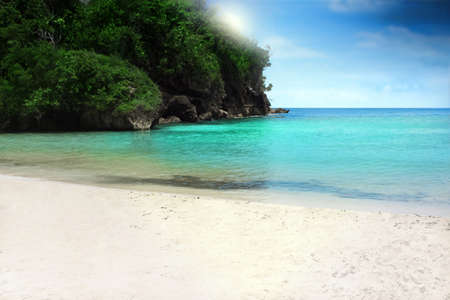 beautiful white sand, clear azure water, and blue sky with clouds