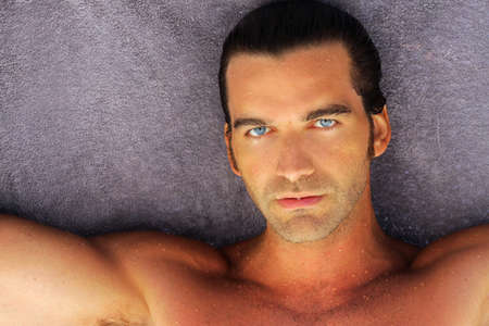 portrait of beautiful suntanned young man with blue eyes Stock Photo - 7710696
