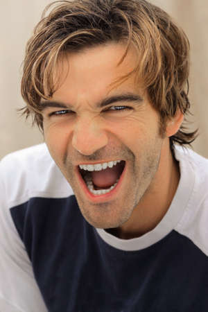 Closeup portrait of a happy handsome young guy, laughing Stock Photo - 7710694