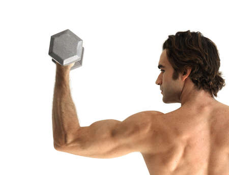 muscular body: Good looking fitness model doing a bicep curl with dumbbell against white background