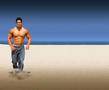 Young muscular male running on an isolated on a beach with lots of copy space photo