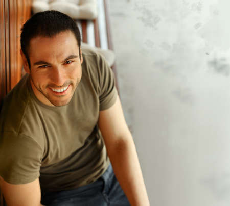 Happy smiling casual guy smiling outdoors photo