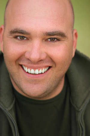 Close up portrait of a happy smiling middle aged man with bald head