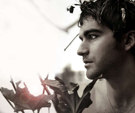 Fine art warm toned black and white portrait of a young man in nature with lots of copy space Stock Photo - 8552111