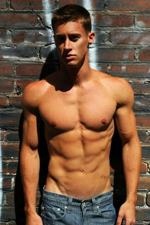 pectorals: Edgy fashion portrait of young muscular man Stock Photo
