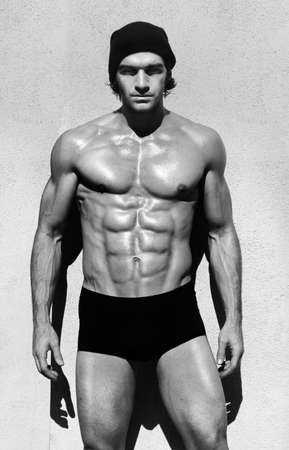 six pack abs: Sexy fine art black and white portrait of a very muscular shirtless maile model posing