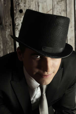 top: Portrait of a  young man in top hat