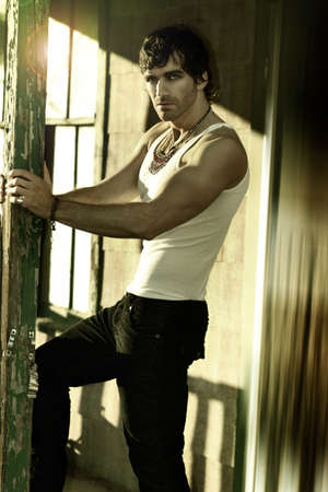 Portrait of a sexy man in white tank top and jeans Stockfoto