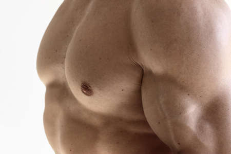 Closeup detail photo of a muscular fit man's bicep and chest Stock Photo - 9789949