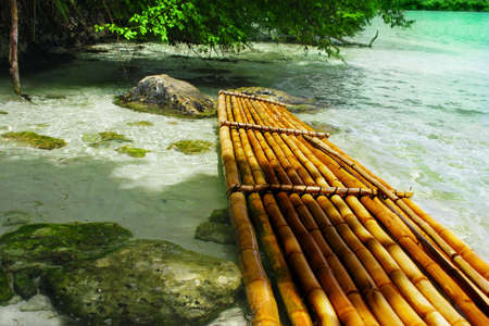 A bamboo raft in clear tropical waters