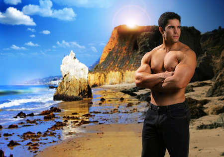 Portrait of a young male fitness model on exotic beach Imagens