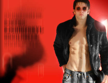 Fashion portrait of edgy male model wearing eye makeup in fur against red background Stock Photo - 9893314