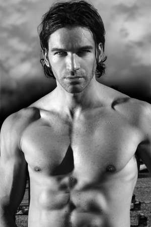 sexy muscular man: Fine art black and white portrait of a beautiful shirtless male model Stock Photo