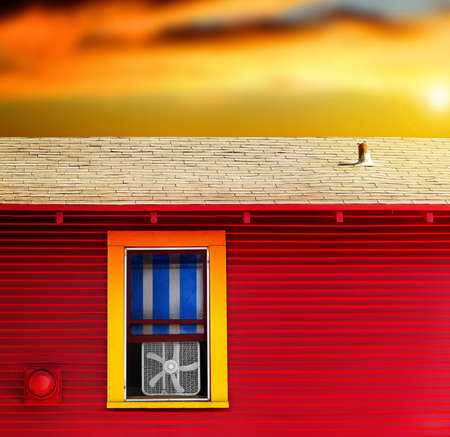 Colorful home exterior with vibrant sky featuring a little window with window fan photo