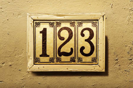 Exterior of a home address with numbers 1 2 3 in sequence
