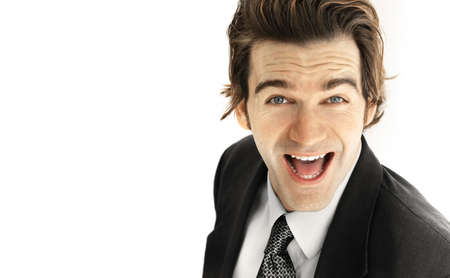 good attitude: Portrait of an excited young businessman with big smile against neutral white background
