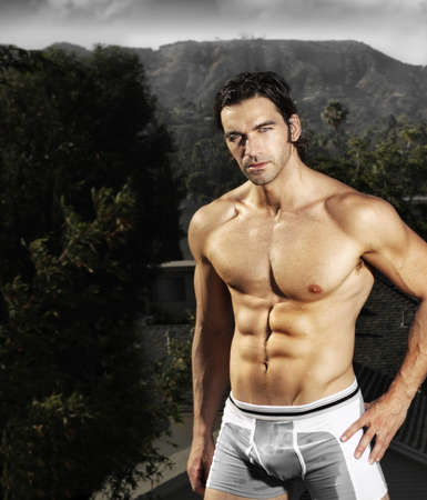 Sexy buff fit male model outdoors Stock Photo