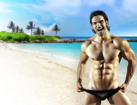 big smile: Sexy fun muscular male fitness model with big smile