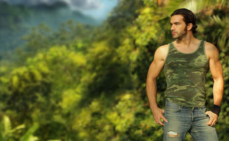 man profile: Portrait of a relaxed casual muscular young man in beautiful natural setting  Stock Photo