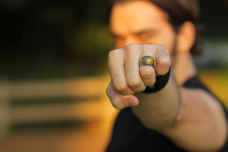Detail of a vintage ring on mans hand with depth of field