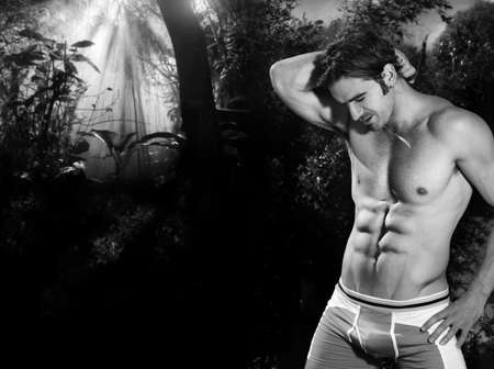 Classic black and white portrait of a young male shirtless fitness model outdoors with copy space Stock Photo - 11731599