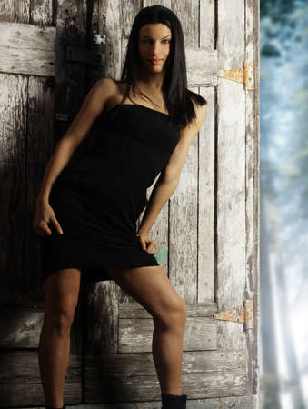 Sexy female fashion model in little black dress against rustic wall Stock Photo - 11854481
