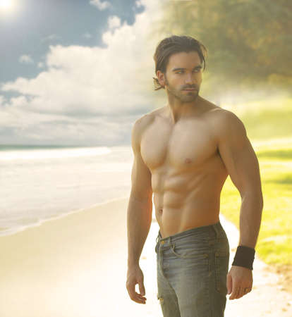 males only: Portrait of a beautiful shirtless man in jeans against the light with a classic retro feeling Stock Photo