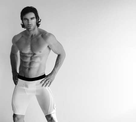 stud: Black and white portrait of a sexy young man in underwear with lots of copy space  Stock Photo