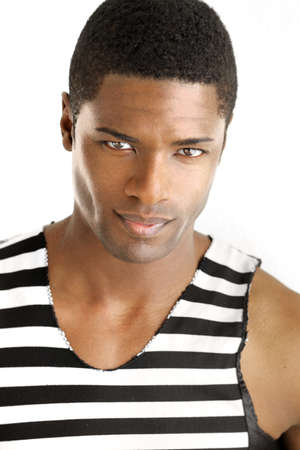 Detailed portrait of a young black man in trendy clothing against white background photo