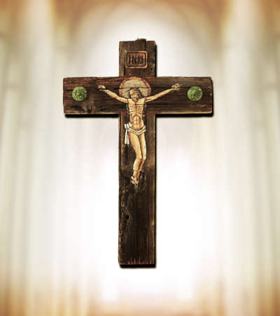 Old wooden cross depicting crucifixion of Jesus Christ photo