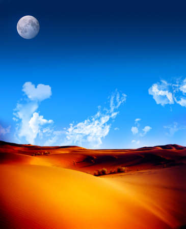 Red sand dunes in Morocca with bright blue sky and fluffy clouds and moon