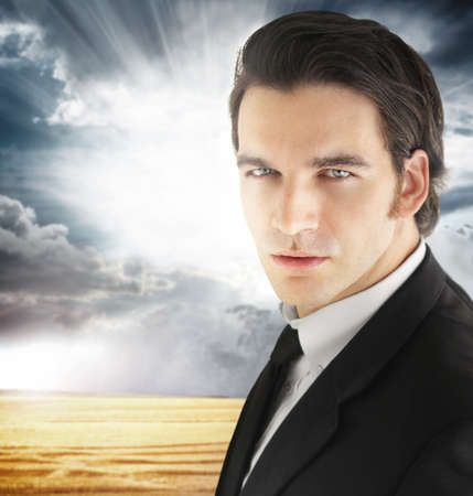 good weather: Good looking modern young businessman against background of dramatic cloudscape