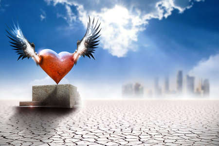Conceptual fine art work depicting a winged heart on a pedastal in barren landscape with city in far background Stock Photo - 12945194