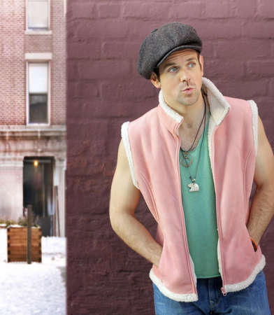 Fashion portrait of a cool trendy young male model in pink vest and casual clothing outdoors  photo