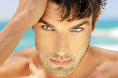 Highly detailed close-up portrait of handsome man with beautiful eyes photo
