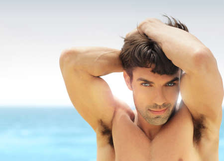 Sexy male model posing at tropical location Stock Photo - 13994713