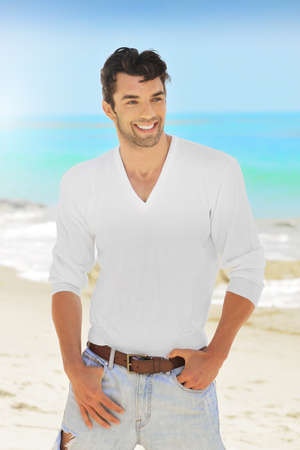 Great looking young man with nice smile outdoors photo