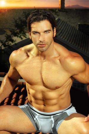 Sexy portrait of fit muscular man in underwear